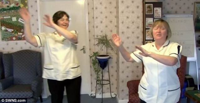 These two members of staff were content to show off their moves for the Happy video