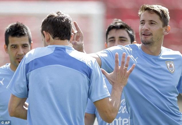 Clowning around: Gaston Ramirez jokes with his team-mates in training on Friday