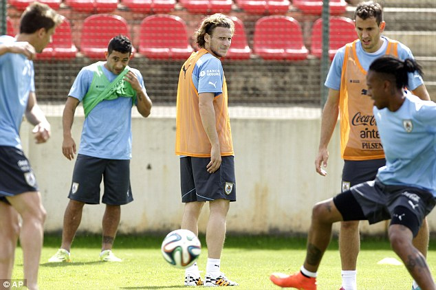 Kickaround: Uruguay's players have a light session after Thursday night's exploits