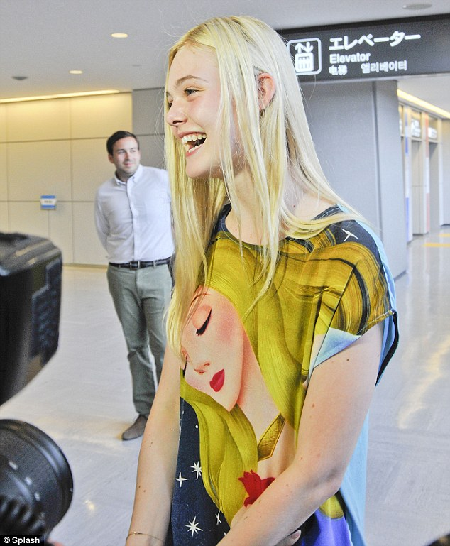 Fresh-faced: The teenage star appeared to have very little makeup on after exiting her international flight
