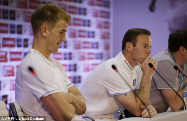 Pensive: England goalkeeper Joe Hart (left), and Wayne Rooney wait for the first question at a press conference after a squad training session  ahead of the game against Costa Rica