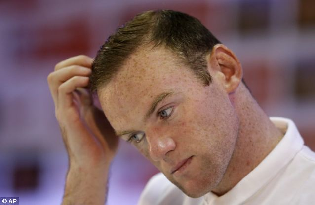 The joy of scoring his first World Cup goal for England cannot hide Wayne Rooney's unhappiness at the post-training press conference