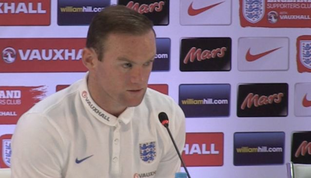 Daddy's turn: An understandably dejected Wayne Rooney faces the press ahead of England's meaningless game against Costa Rica
