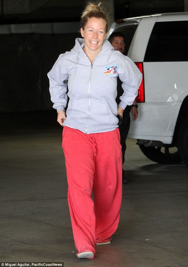 Upbeat: Earlier on Friday, Kendra was spotted smiling as she ran some errands dressed in baggy sweats that covered up her postpartum figure