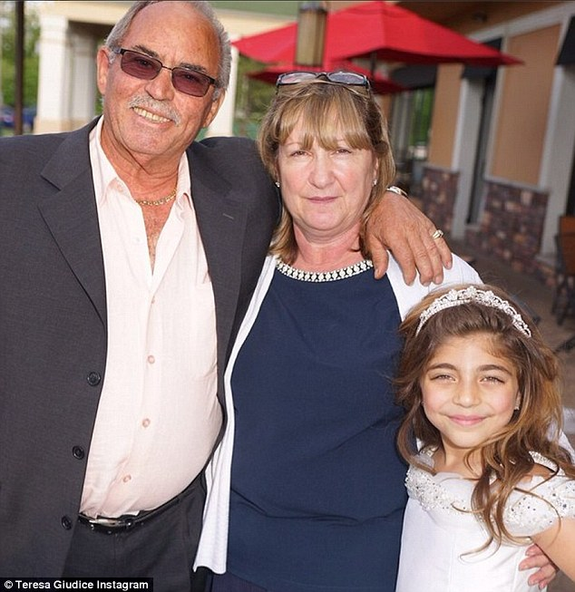 Special moment: Frank is pictured here with his wife Filomena and granddaughter Milania at her communion