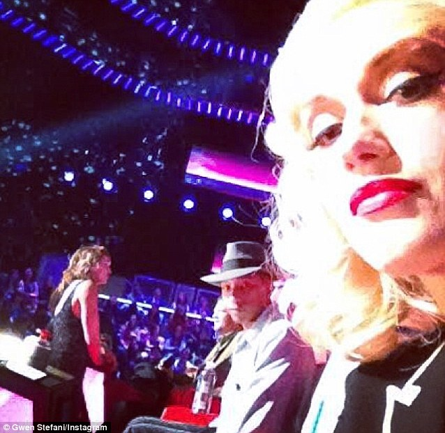 Sneak peek: Stefani shared her own photo from behind the scenes on Wednesday with Pharrell in the background