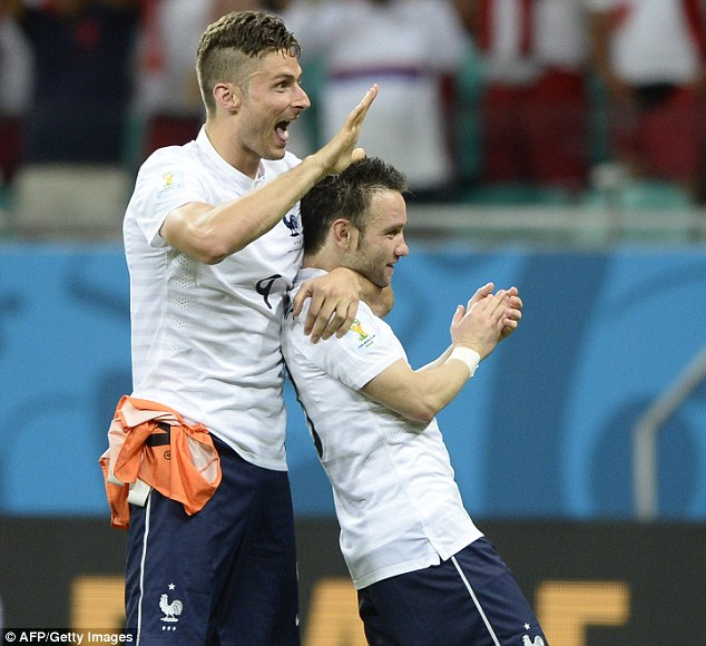 Big man, small man: Olivier Giroud (left) and Mathieu Valbuena celebrate after their triumph over the Swiss