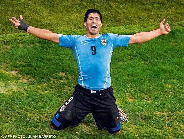 Super star: Liverpool striker Luis Suarez celebrates after scoring a second goal during a Group D football match between Uruguay and England at the Corinthians Arena in Sao Paulo on Thursday night
