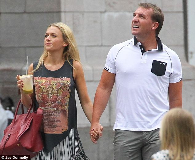 Mr Rodgers gawps at the museum's stunning architecture as he walks hand-in-hand with Ms Hind