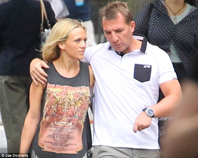 Liverpool boss Brendan Rogers is seen arm-in-arm with Charlotte Hind, Liverpool's former travel coordinator to New York's Museum of Natural History on the day of England's match with Uruguay