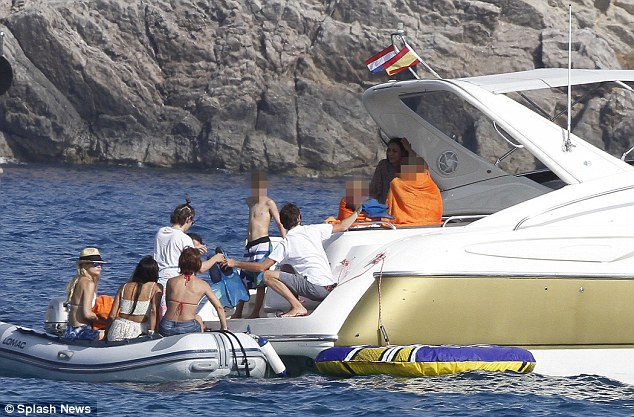 All aboard: The group transfer from the dinghy to the larger boat