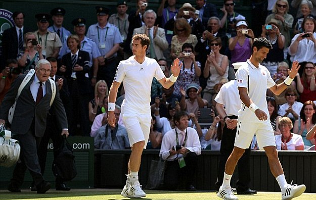 Special day: Dickson (left) carries the bags of Andy Murray (centre) and Novak Djokovic before the 2013 final