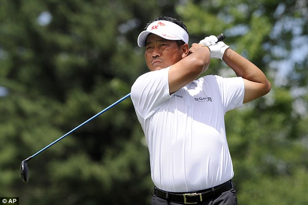 In the mix: KJ Choi, pictured here watching his drive on the second, is tied third after shooting 69 on day three