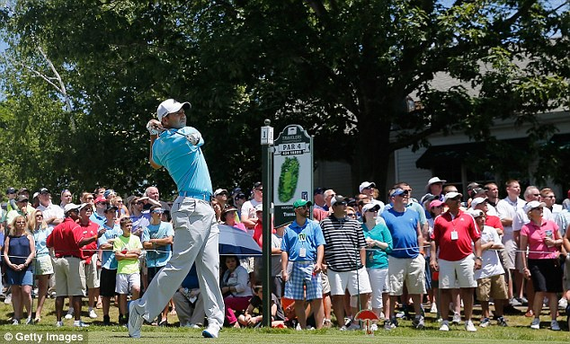 In contention: Sergio Garcia, pictured here teeing off on the first, is two shots off the lead in Connecticut