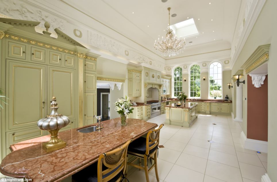 Enthusiastic home cooks will love the marble topped surfaces in the enormous kitchen, although with a staff wing containing four bedrooms, the new owner may not necessarily be preparing their own food