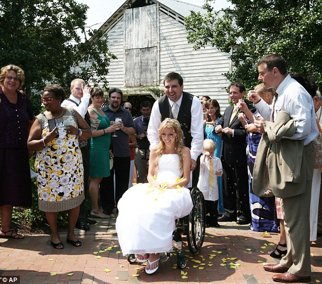 Mother-to-be: Rachelle Friedman and husband Chris Chapman, leave their 2011 wedding reception