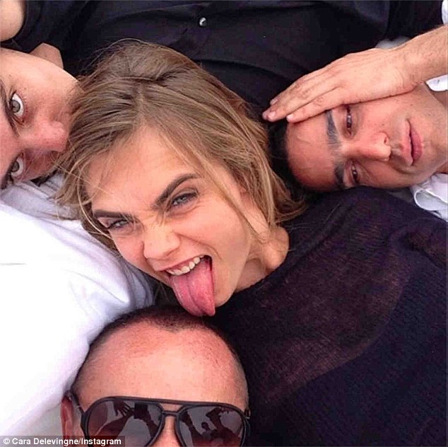 It's not all hard work! Cara posted this fun photo as she relaxed with some pals during a break in the shoot