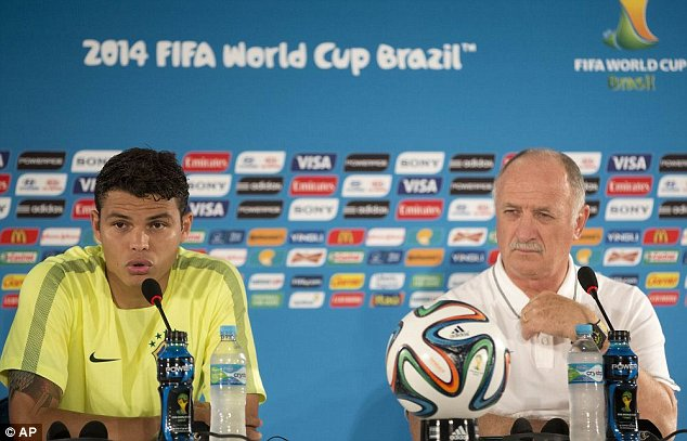 Brazil's Thiago Silva, left, speaks, as Brazil's coach Luiz Felipe Scolari looks on during a news conference the day before the group A World Cup soccer match between Brazil and Cameroon at the Estadio Nacional in Sunday, June 22, 2014. The hosts need at least a draw to advance to the second round, and a win will likely secure first place. Cameroon is already eliminated after losing its first two matches. (AP Photo/Andre Penner)