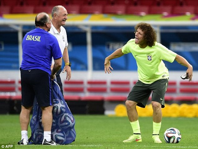 Clown: The defender, who will join PSG after the tournament, fools around to amuse Scolari