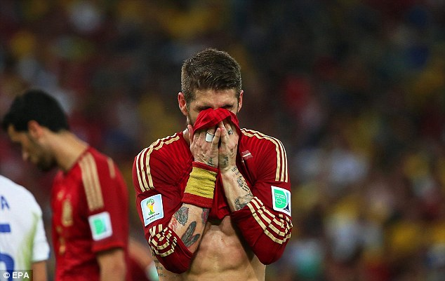 All over: Sergio Ramos rues Spain's defeat to Chile which ends their reign as World Cup holders