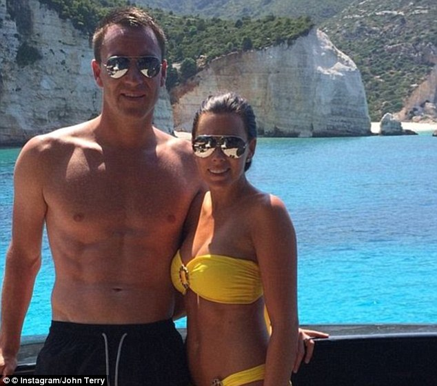 Sun-soacked: While England were being knocked out of the World Cup, John Terry was on holidays with his wife Toni