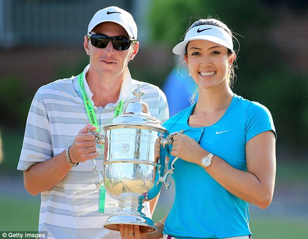 Long time coming: Wie poses with the Open trophy and her caddie, Duncan French in North Carolina