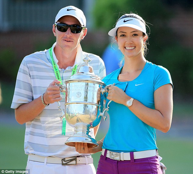 Caddie: Wie holds the trophy with caddie Duncan French after winning the 69th U.S. Open on Sunday