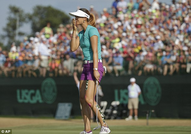 Finally: Wie shows her disbelief after sinking her final putt to win the US Women's Open