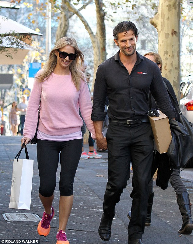 Holding on: Former The Bachelor Australia star Tim Robards and his girlfriend Anna Heinrich held hands during a lunch date in Sydney on Saturday