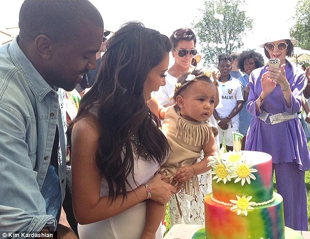 Big day! Kourtney hosted her niece North West's first birthday party at her house on Saturday, North pictured with mother Kim and father Kanye