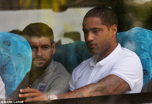 Bon voyage: Steven Gerrard and Glen Johnson look reflective as they leave the team hotel in Rio de Janiero