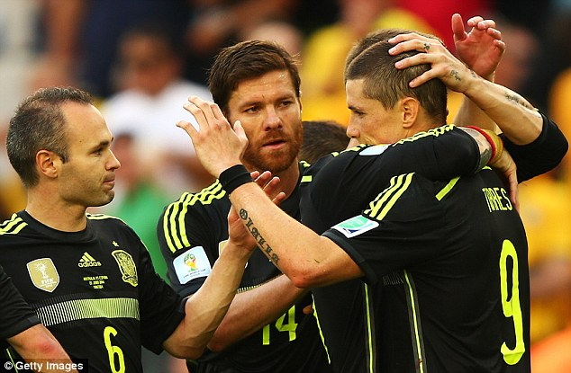 Something to cheer: Fernando Torres celebrates his goal with Xabi Alonso