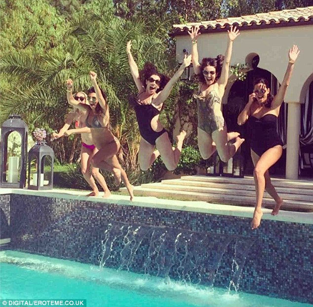Feeling energetic: Pregnant Kourtney Kardashian (second from left) jumped into a swimming pool at her new Calabasas house on Sunday