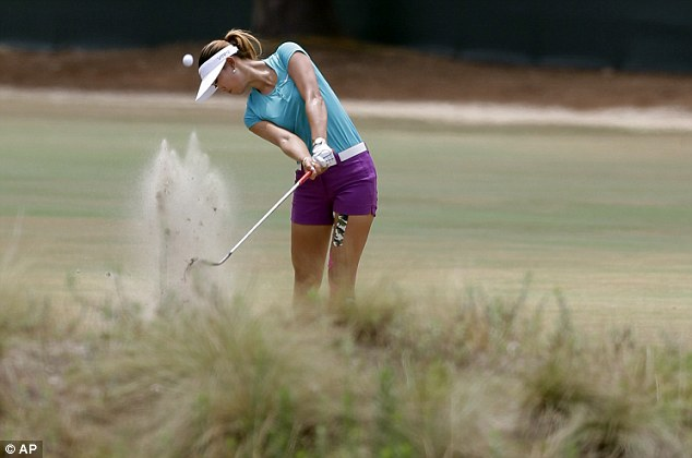Good connection: Wie hits out of a waste area on the third hole on her way to shooting a level-par 70