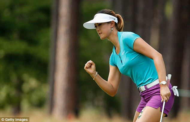 Get in the hole! Wie celebrates holing an eagle putt on the 10th green during her final round