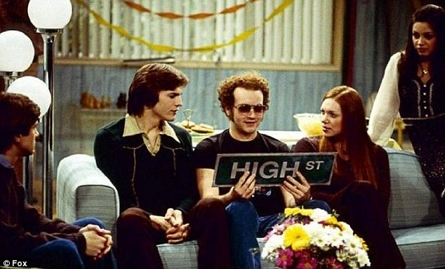 'We grew up together!' Prepon, as a red-head, co-starred in the hit That '70s Show with a young Ashton Kutcher and Mila Kunis, far right