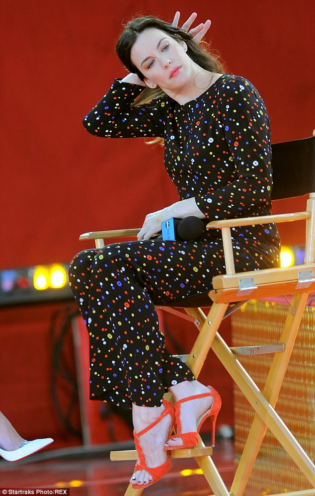 Stunner: Liv looked beautiful in a polka dot onesie and elegant red heels as she spoke about her show