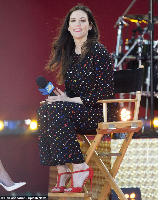 Wispy locks: Liv Tyler's hair certainly got a little volume as she appeared on Good Morning America in New York on Friday to speak with host Amy Robach