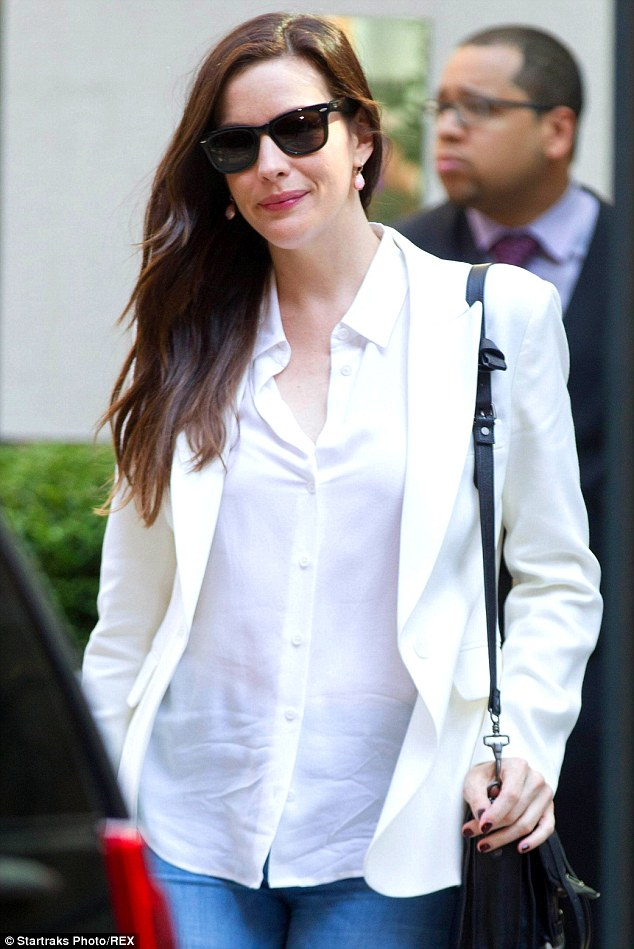 Classy: The 36-year-old actress looked elegant in a white blazer over a crisp white button-up shirt