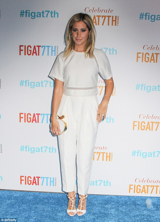 Woman in white: The star donned all-white including a 3rd Floor top and pants with Giuseppe Zanotti heels