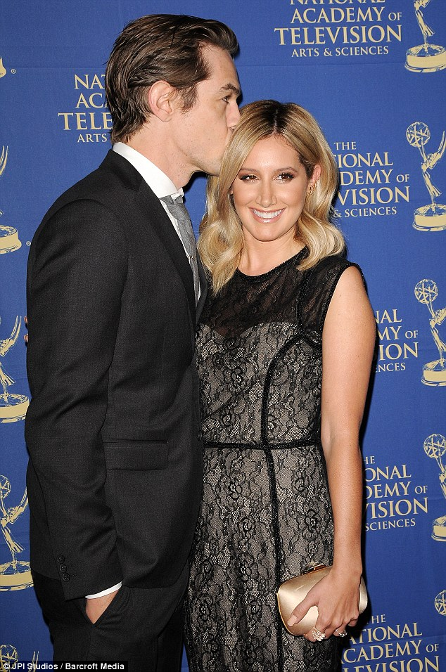Sweet kiss! Christopher French kisses fiancee Ashley Tisdale at the 41st Annual Daytime Creative Arts Emmy Awards at Westin Bonaventure Hotel on Friday in Los Angeles, California