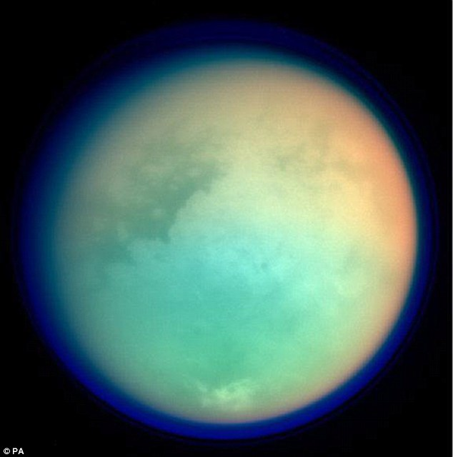 Comparison: Titan has weather systems similar to those of watery Earth, with wind and rain carving out strikingly familiar landscapes