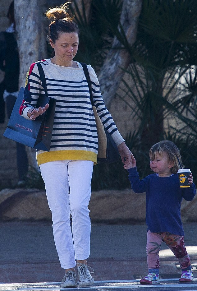 Girls' time: Little Ever was very spoilt as she strut down the street with her mum and a coffee in hand