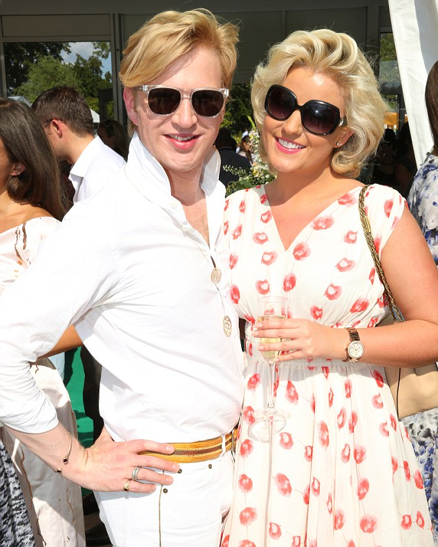 Summer days: Soprano Natalie Coyle looked lovely in a printed sun-dress as she posed alongside Henry Conway