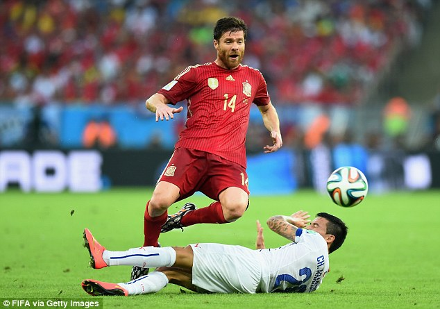 Outgunned: Alonso was unable to make the difference in midfield as Spain lost against Holland and Chile