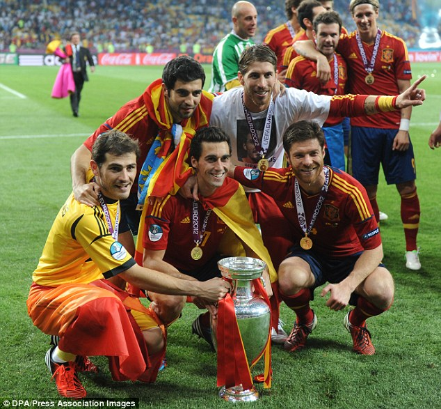 Happier times: Alonso celebrates the Euro 2012 victory - Spain's third major trophy win on the trot
