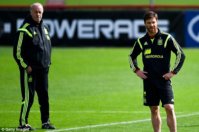 Happy campers? Vicente Del Bosque and Alonso could both soon find themselves leaving the Spain setup
