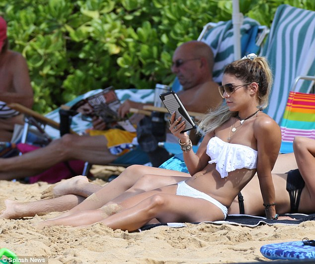 Relaxing: The Spring Breakers star took time to enjoy a nice beach read