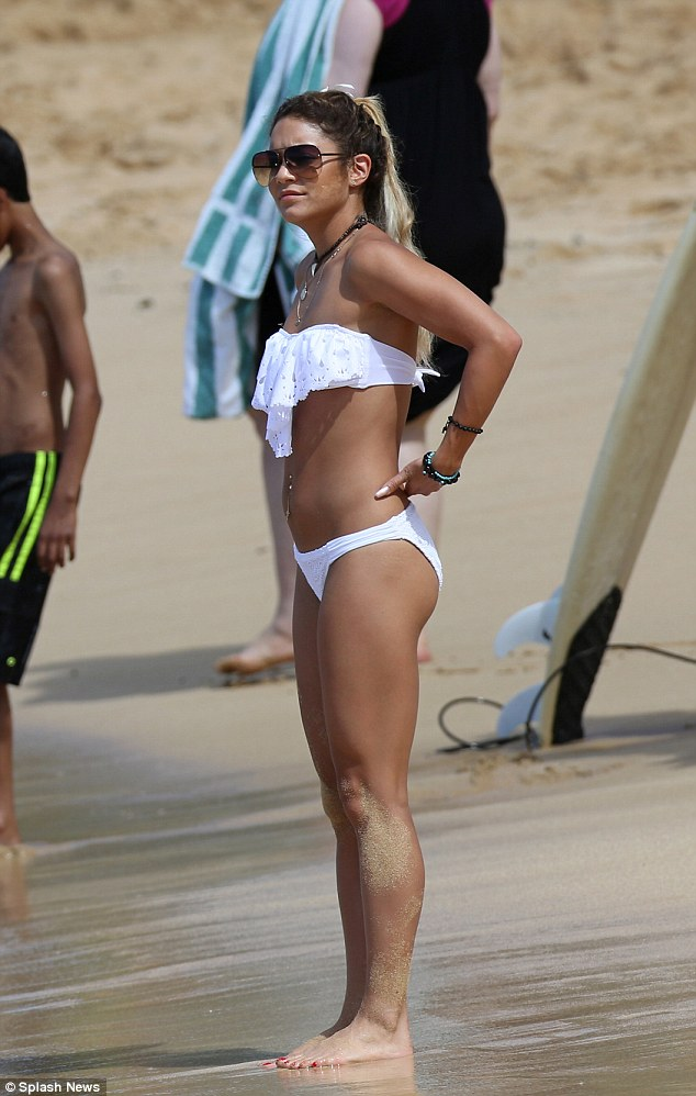 Long and lean: The 25-year-old showed off her bronze glow while on the beach