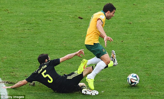 Taking a tumble: Tommy Oar is sent sprawling after a challenge by Juanfran